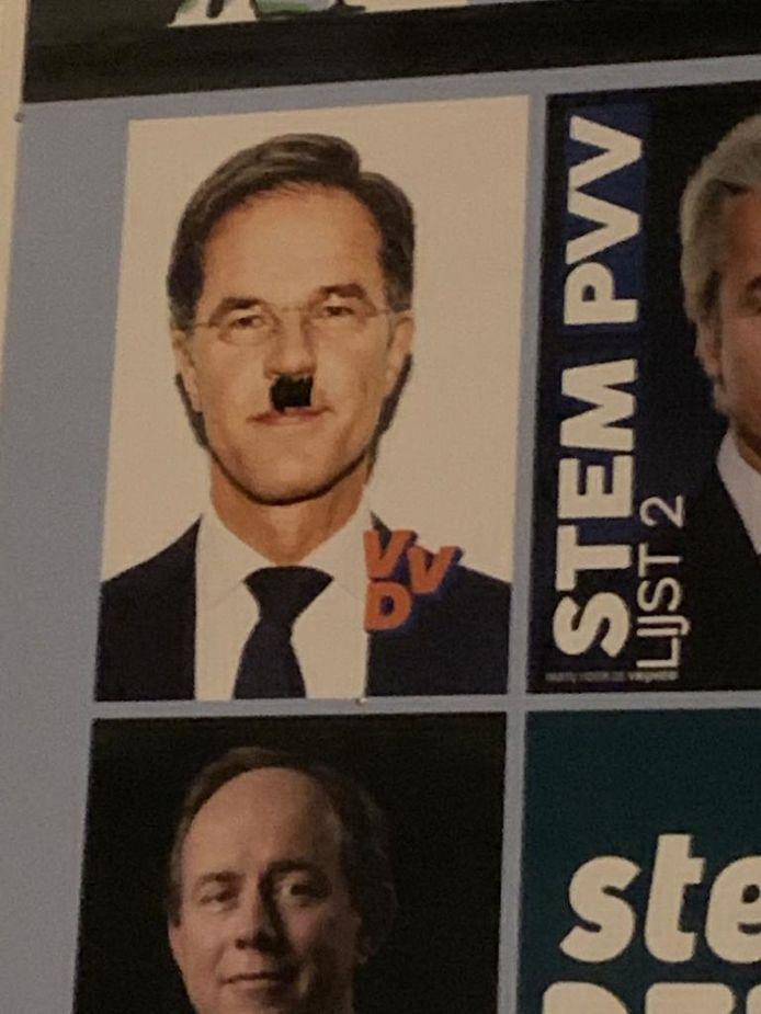 Poster van VVD-lijsttrekker Mark Rutte beklad met hitlersnor.