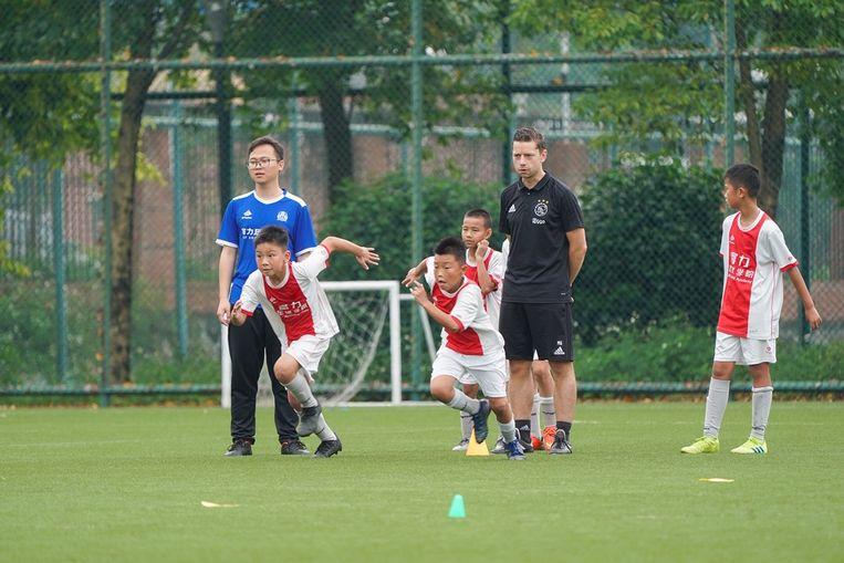 Op de Ajaxschool in het zuiden van China worden 350 jongens van 7 tot 17 jaar opgeleid.  Beeld Ajax Coaching Academy