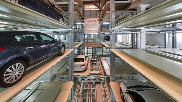 Er komt geen mensenhand te pas aan het parkeren van auto's in een volautomatische parkeergarage Beeld Quabbe+Tessmann