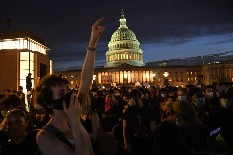 Protesten voor het Witte Huis in Washington. Beeld AFP