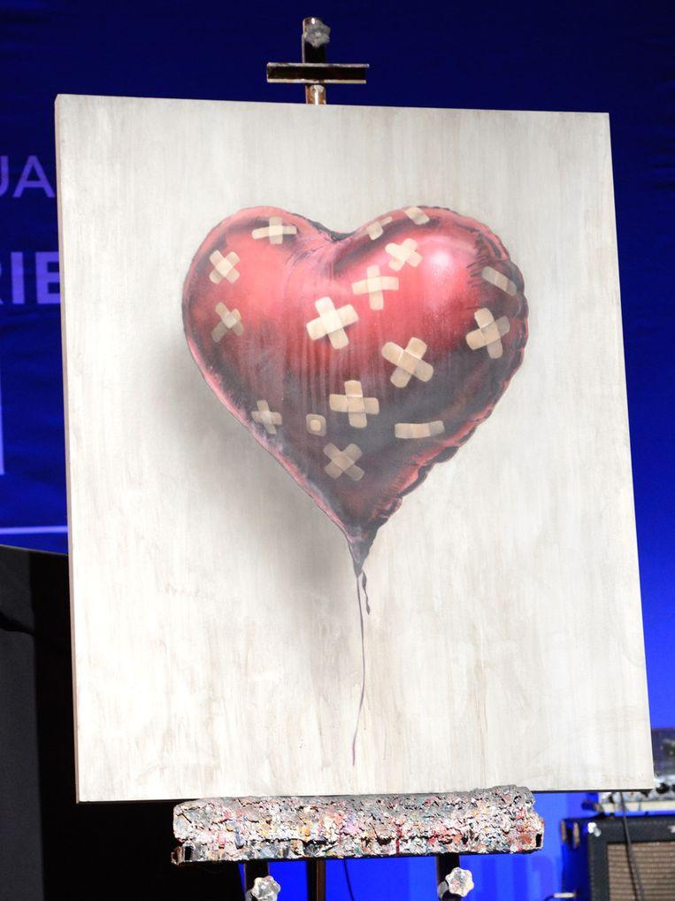 Voor dit schilderij van Banksy had Chris Martin 650.000 dollar over. Beeld GETTY