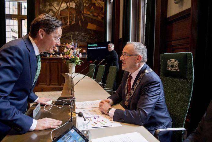 Joost Eerdmans (l) en burgemeester Aboutaleb.