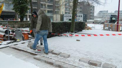 Sneeuw of niet? Deze mannen gaan door met de centrumwerken