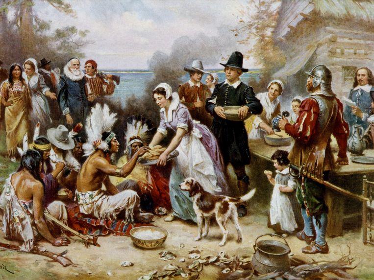 Het waren indianen die kolonisten gastvrij onthaalden toen zij aan land kwamen, maar in de mythe keren Amerikanen de rollen graag om. Beeld Library of Congress