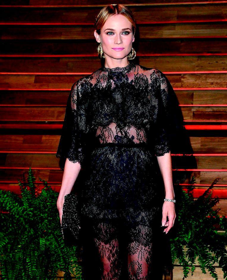 Actrice Diane Kruger laat hier zien hoe je in doorzichtig zwart naar een feest kunt zonder voor sloerie te worden versleten. Beeld rv