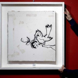 kunstwerk-banksy-brengt-170000-euro-op-bij-veiling