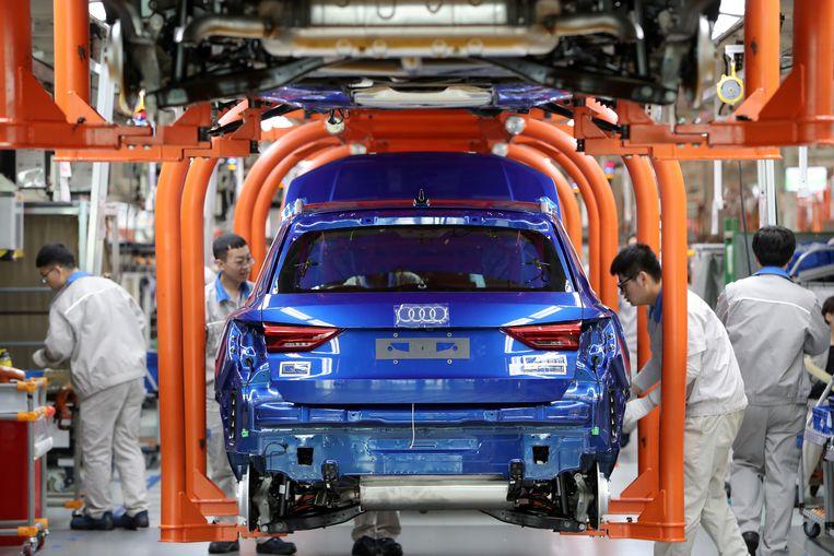 Werk aan een Audi in de Chinese havenstad Tianjin. Het verdrag zou Europese automakers toegang geven tot voorheen ontoegankelijke sectoren van de Chinese economie. Beeld Reuters