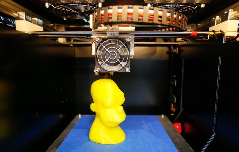 Een 3D-printer op de DeBIT Trade Fair in Hanover, 's werelds grootste beurs voor computers en software. Beeld REUTERS