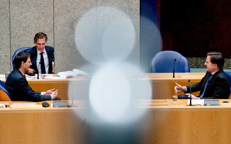 Demissionair Minister Wopke Hoekstra van Financiën (CDA), demissionair Minister Bas van 't Wout van Economische Zaken en premier Mark Rutte tijdens een debat over het aftreden van het kabinet naar aanleiding van de toeslagenaffaire. Beeld ANP