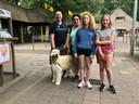 Ron en Lisette Schouten met hun 11-jarige tweeling en 1-jarige bouvier Lexi.