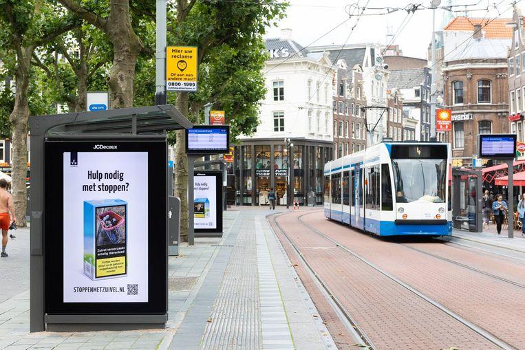De gewraakte poster van Dier&Recht in het Amsterdamse straatbeeld. Beeld Dier&Recht