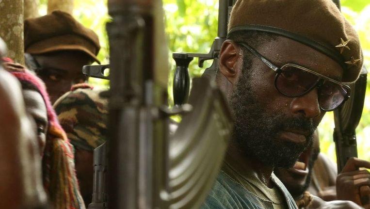 Nog voor het einde van dit jaar pakt Netflix uit met een eigen langspeelfilm, 'Beast of No Nation', met de Britse acteur Idris Elba in de hoofdrol. Beeld netflix