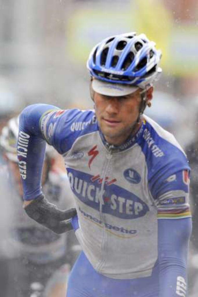 Tom Boonen reed naast Cavendish voor het eerst de Kemmelberg op, maar was toen al met een lekke band.uit de kopgroep weggevallen. Beeld UNKNOWN