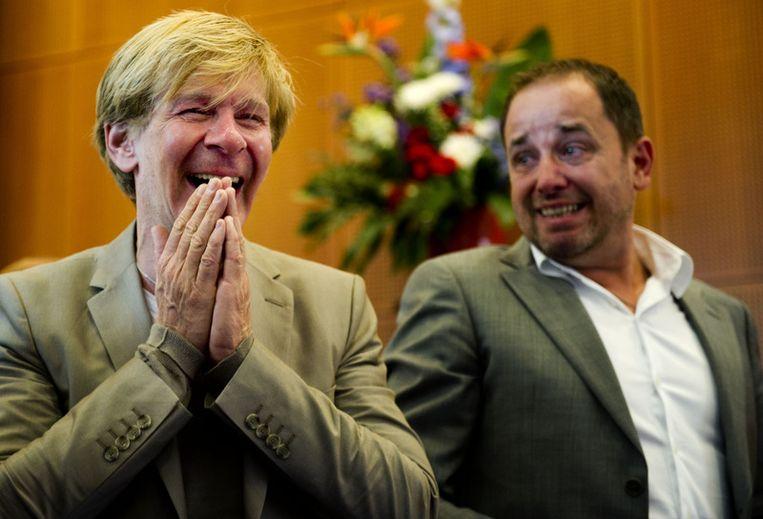 Modeontwerper Addy van den Krommenacker ontvangt vrijdag een koninklijke  onderscheiding uit handen van burgemeester Ton Rombouts in Den Bosch.  Rechts zijn partner Bas Meulenbroek. Foto ANP.<br /> Beeld