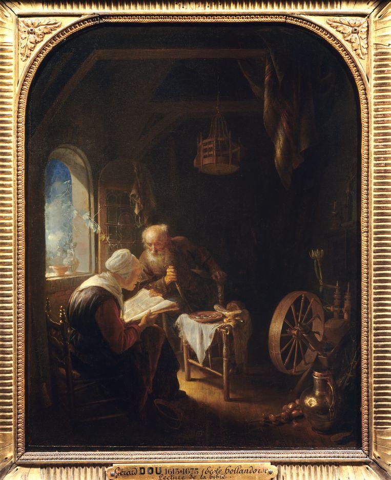 Gerrit of Gerard Dou:  De Bijbel lezend (ca. 1645). Louvre, Parijs.  Beeld Getty