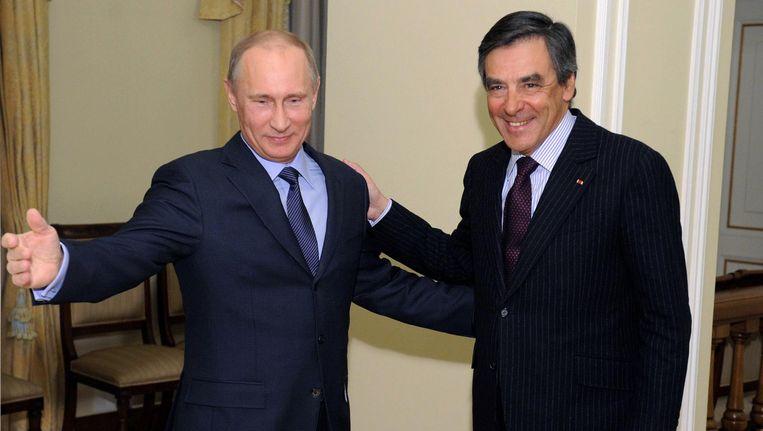 Poetin en Fillon. Beeld ap