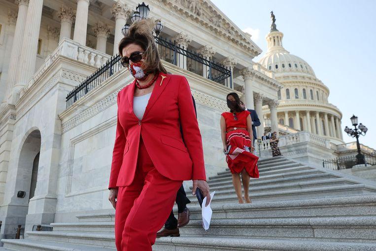 Nancy Pelosi gisteren voor het Capitool in Washington DC. Beeld AFP
