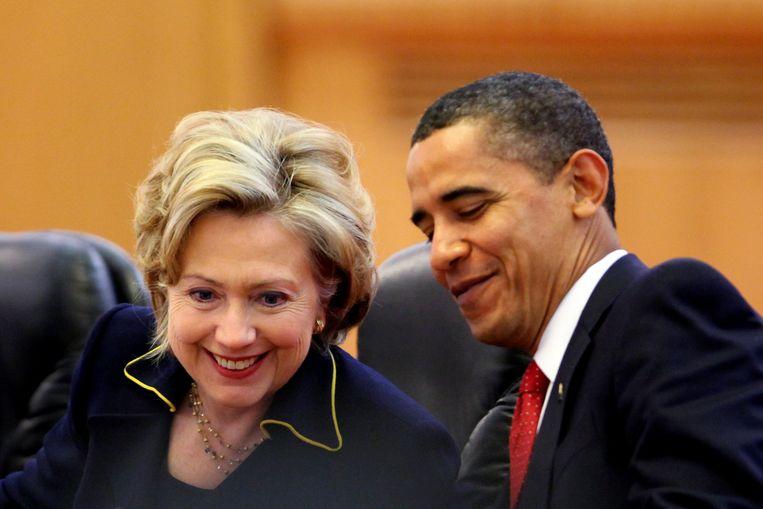 Clinton en president Barack Obama in 2009. Beeld getty