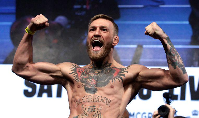 Conor McGregor, hier in aanloop naar zijn beroemde gevecht tegen de bokser Floyd Mayweather Jr. in 2017. Beeld AFP