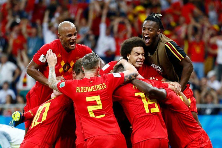 De Rode Duivels vieren hun goal tegen Japan. Beeld Photo News