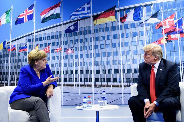De Duitse bondskanselier Angela Merkel en Donald Trump.