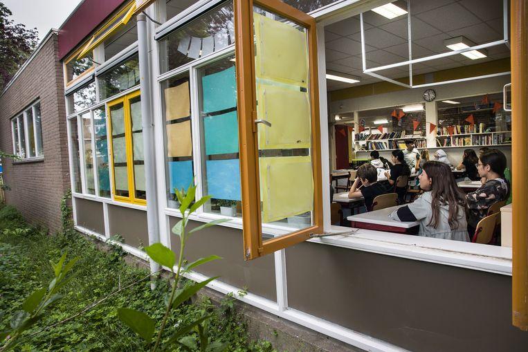 Basisschool Samen Onderweg in Utrecht had voor de zomervakantie de ramen wijd open. Beeld Arie Kievit