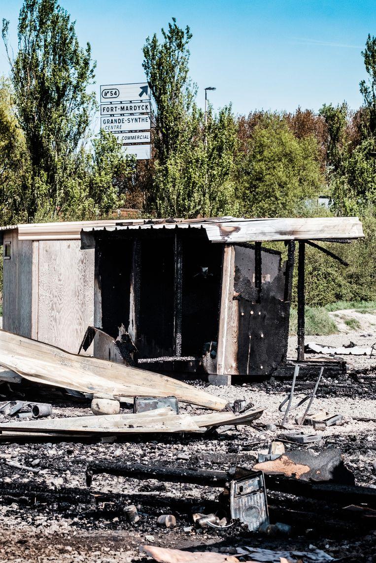 Platgebrande shelters. Beeld Bob Van Mol