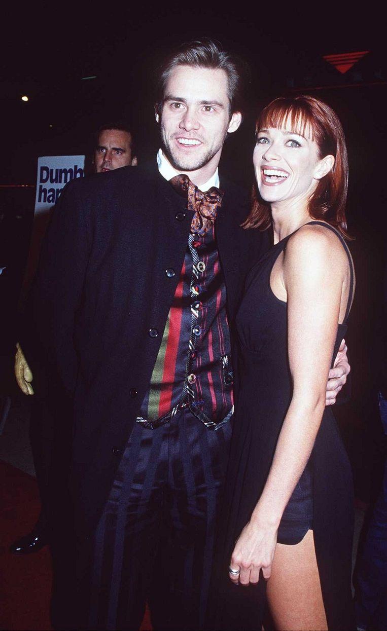 Jim Carrey op de première van 'Dumb and Dumber' in '94. Beeld Getty