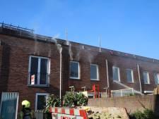 Brand in Spouwmuur in de Bogotástraat, vuur slaat over op naastgelegen huizen