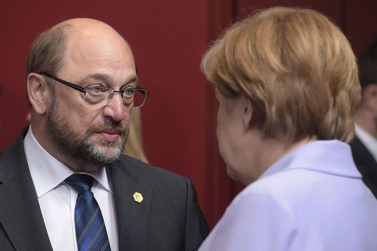Martin Schulz met Duits bondskanselier Angela Merkel. Beeld PHOTO_NEWS