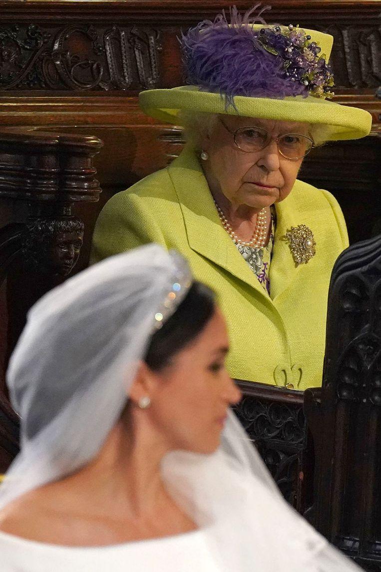 Meghan Markle en Queen Elizabeth tijdens het huwelijk van Markle en prins Harry. Beeld AFP