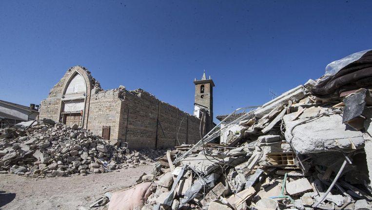 Een verwoeste kerk in het Italiaanse dorp Amatrice. Beeld epa