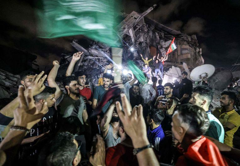 Palestijnen vieren de wapenstilstand als een overwinning. Beeld AFP