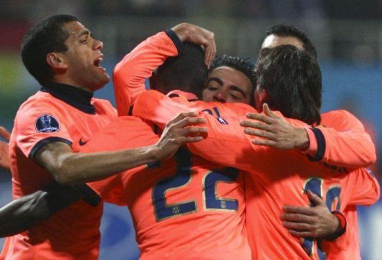 Spelers van FC Barcelona vieren de gelijkmaker tegen Dinamo Kiev. ANP Beeld