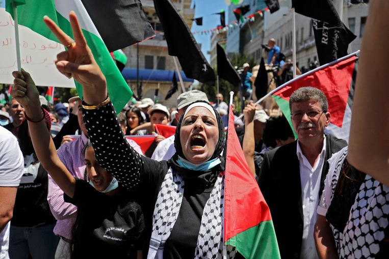 Protesterende Palestijnen in Ramallah. Beeld AFP