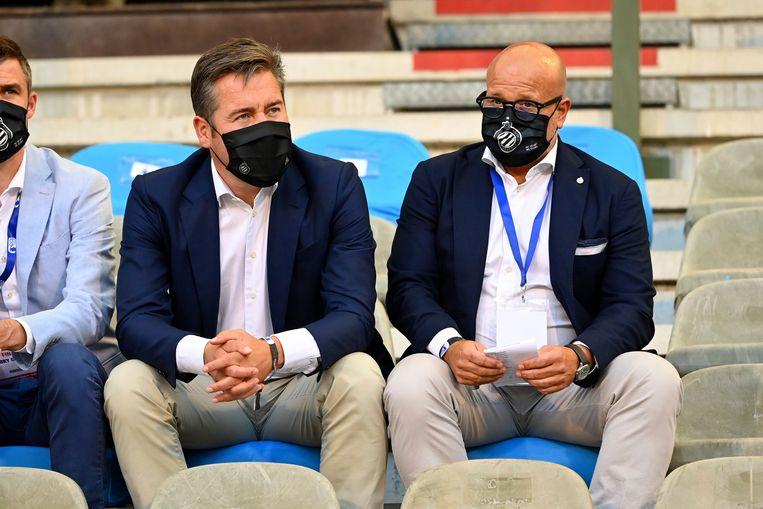CEO Vincent Mannaert en voorzitter Bart Verhaeghe zitten naast elkaar in de tribune. Beeld Photo News