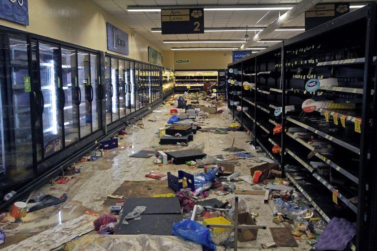 Een geplunderde supermarkt in Managua. Beeld AFP