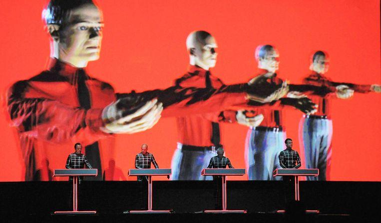 Een optreden van Kraftwerk in 2012. Florian Schneider verliet de band vier jaar eerder in een ruziesfeer. Beeld EPA