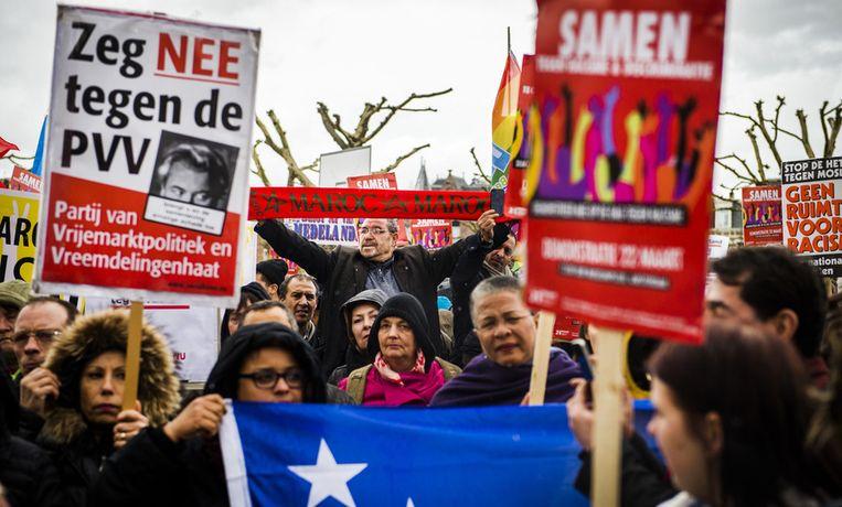 Actievoerders protesteren tegen racisme en de PVV tijdens een demonstratie op het Museumplein.  Beeld anp