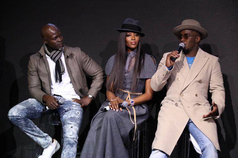 Djimon Hounso, Naomi Campbell en Sean Diddy Combs bij de presentatie van de nieuwe Pirelli-kalender. Beeld Photo News