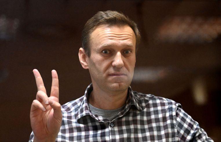 De Russische oppositieleider Aleksej Navalny tijdens zijn proces in Moskou. Beeld AFP