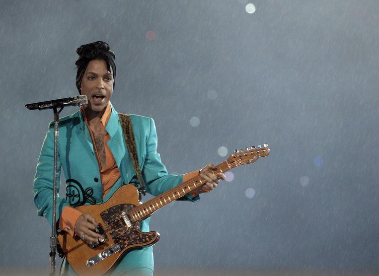 Prince, in 2007, tijdens een concert in Miami. Beeld AFP