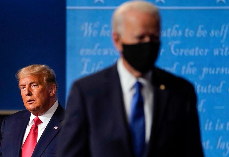 Donald Trump (links) en zijn opvolger Joe Biden. Beeld AP