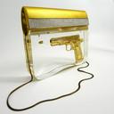 Lady K, gouden pistool en kogel in acrylaat gegoten. Foto Atelier Ted Noten.