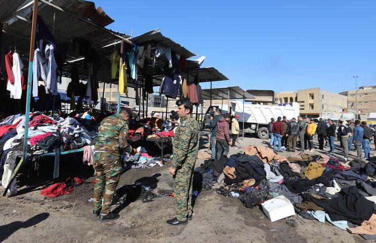 Op de markt werden vooral tweedehands kleren verkocht. Beeld Ahmed Jalil / EPA