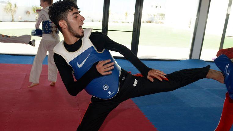 Jaouad Achab (l) is de nieuwe wereldkampioen taekwondo Beeld PHOTO_NEWS