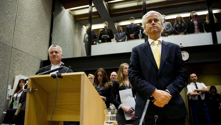 Geert Wilders in de rechtszaal tijdens het voorlezen van de uitspraak in de strafzaak tegen hem in 2011. Beeld anp
