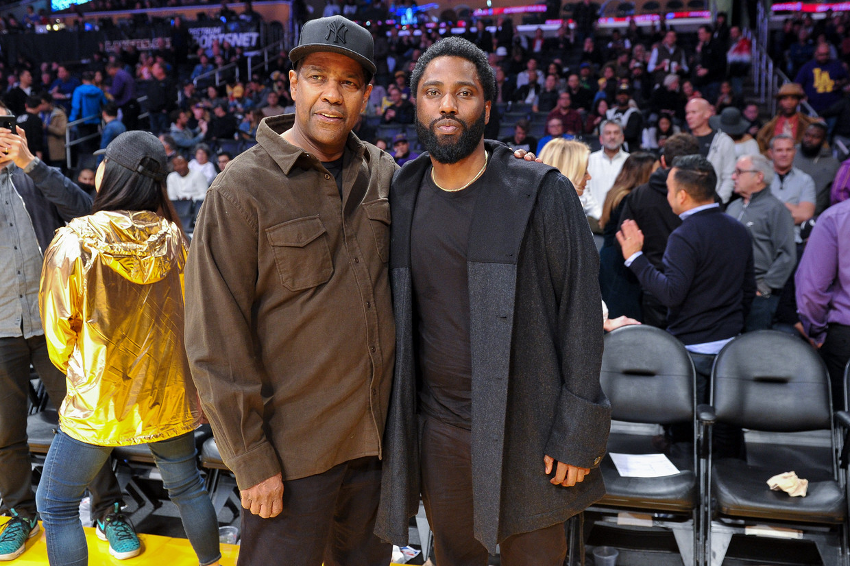 Acteurs Denzel Washington en zoon John David Washington in 2018. Beeld Getty Images