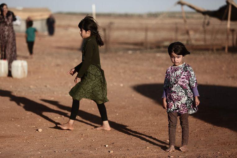 Kinderen in een vluchtelingenkamp in de Syrische provincie Idlib, die in handen is van rebellengroeperingen.  Beeld AFP