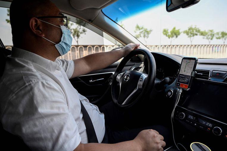 Een Didi-chauffeur in Beijing. Beeld AFP